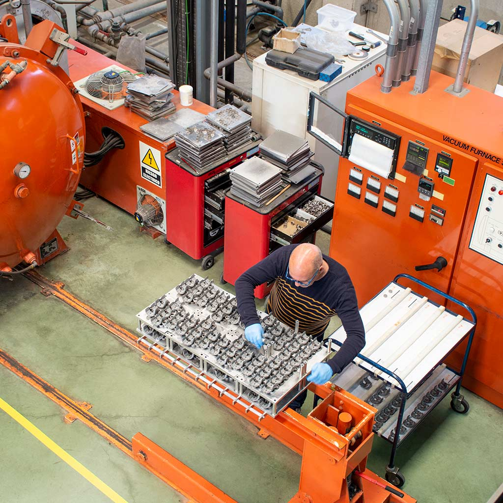 Technician in implant coating heating process