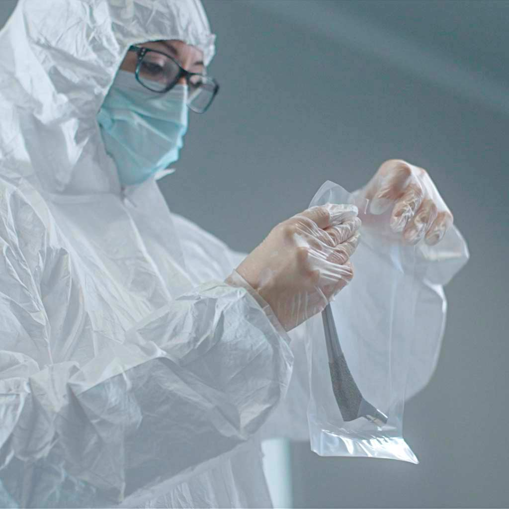 Treatment of coating for surgical implants in a clean room